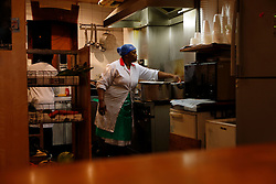 UK ENGLAND LONDON 19AUG11 - Jamaican-born Beverley Wiilson (55) cooks and cleans at the R & B Cafe she runs in Clarence Road, Hackney, east London. During the August riots in London, Clarence Road in Hackney featured some of the most devastating scenes of looting and violence...jre/Photo by Jiri Rezac..© Jiri Rezac 2011