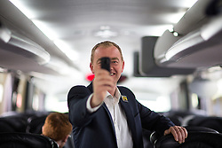 © Licensed to London News Pictures . 22/06/2016 . Cambridge , UK . Liberal Democrat leader TIM FARRON taking a 360 degree photo on the Lib Dem EU Remain Battle Bus , en route to a rally in Cambridge . Photo credit : Joel Goodman/LNP