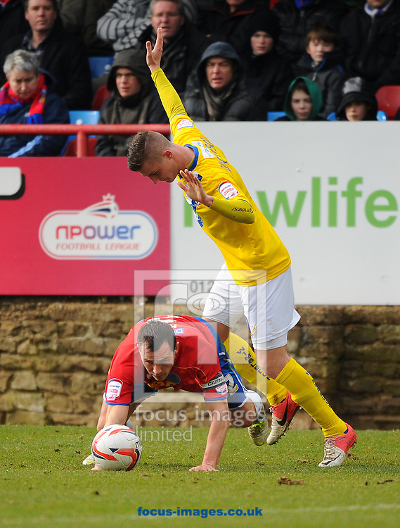 Picture by Seb Daly/Focus Images Ltd +447738 614630.16/03/2013.Ben Herd of Aldershot Town and Brennan Dickenson of AFC Wimbledon during the npower League 2 match at the EBB Stadium, Aldershot.