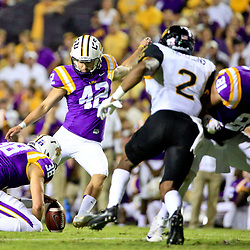 Oct 15, 2016; Baton Rouge, LA, USA;  LSU Tigers place kicker Colby Delahoussaye (42) kicks a field goal against the Southern Miss Golden Eagles during the second quarter of a game at Tiger Stadium. Mandatory Credit: Derick E. Hingle-USA TODAY Sports