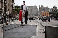 Anti Mubarak protesters occupy Cairo's Tahrir Square.<br /> Protester watching access against pro Mubarak incursion to Tahrir Square near the Egyptian Museum. 04 February 2011.