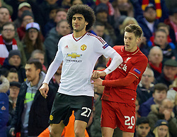 LIVERPOOL, ENGLAND - Thursday, March 10, 2016: Manchester United's Marouane Fellaini elbows Liverpool's Adam Lallana during the UEFA Europa League Round of 16 1st Leg match at Anfield. (Pic by David Rawcliffe/Propaganda)