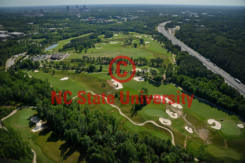 Aerial of Lonnie Poole Golf Course on Centennial Campus, looking northeast towards downtown Raleigh.