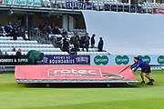 Groundstaff removing the covers after a heavy rain shower which has delayed the start of play during the Specsavers County Champ Div 1 match between Somerset County Cricket Club and Essex County Cricket Club at the Cooper Associates County Ground, Taunton, United Kingdom on 26 September 2019.