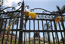 Flowers left by parishioners on the gate at the Shrine Our Lady of Charity-Ermita de La Caridad, that remained closed after Hurricane Irma passed over Miami, on Tuesday, September 12, 2017. Photo by Pedro Portal/El Nuevo Herald/TNS/ABACAPRESS.COM