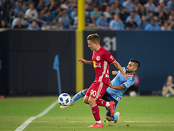 August 22, 2018 - Bronx, New York, United States - New York City midfielder MAXIMILIANO MORALEZ (10) clears the ball away from New York Red Bulls midfielder MARC RZATKOWSKI (90) during a regular season match at Yankee Stadium in Bronx, NY.  New York City FC tie the New York Red Bulls 1 to 1 (Credit Image: © Mark Smith via ZUMA Wire)