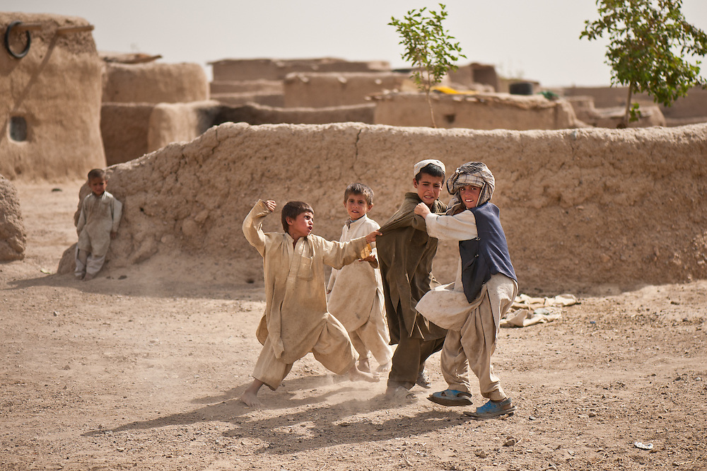 A fistfight between Afghan children near Forward Operating Base Howz-e Madad.
