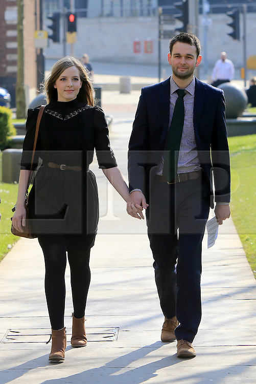 """© Licensed to London News Pictures. 9/05/2016. Belfast, Northern Ireland, UK.  Amy and Daniel McArthur from Ashers Baking Company arrive at Belfast High Court for the start of an Appeal hearing over the so called 'gay marriage cake row'. The legal appeal by Ashers Baking Company in the case is to be heard over two days. In May last year a judge at Belfast County Court ruled that the bakery had acted unlawfully. The court ordered Ashers to pay £500 damages after Judge Isobel Brownlie said the customer had been treated """"less favourably"""" contrary to the law and the bakery had breached political and sexual orientation discrimination regulations. But the McArthur family who own and run Ashers decided to challenge the ruling following consultations with their legal advisors. The family has been given the full support of The Christian Institute, which has funded their defence costs. The legal case followed a decision in May 2014 by Ashers to decline an order placed at its Belfast store by a gay rights activist who asked for a cake featuring the Sesame Street puppets, Bert and Ernie, and the campaign slogan, 'Support Gay Marriage'. The customer also wanted the cake to feature the logo of a Belfast-based campaign group QueerSpace. Ashers, owned by Colin and Karen McArthur, refused to make the cake because it carried a message contrary to the family's firmly-held Christian beliefs. They were supported by their son Daniel, the General Manager of the company. But the Equality Commission for Northern Ireland (ECNI) launched a civil action against the family-run bakery, claiming its actions violated equality laws in Northern Ireland and alleging discrimination under two anti-discrimination statutes – The Equality Act (Sexual Orientation) Regulations (NI) 2006 and The Fair Employment and Treatment (NI) Order 1998. Photo credit : Paul McErlane/LNP"""