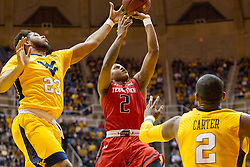 Mar 2, 2016; Morgantown, WV, USA; Texas Tech Red Raiders guard Devon Thomas (2) is blocked by West Virginia Mountaineers forward Esa Ahmad (23) during the first half at the WVU Coliseum. Mandatory Credit: Ben Queen-USA TODAY Sports