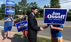 June 13, 2017 - Marietta, Georgia, U.S. -  JON OSSOFF, the Democratic candidate for Congress in Georgia's Sixth District, stops by to greet supporters as they hold campaign signs near the East Cobb County Government Service Center, one of the sites for early, in-person voting in the district.  Ossoff is competing against Republican candidate Karen Handel forthe open Congressional seat in a special election to be held on June 20.(Credit Image: © Brian Cahn via ZUMA Wire)