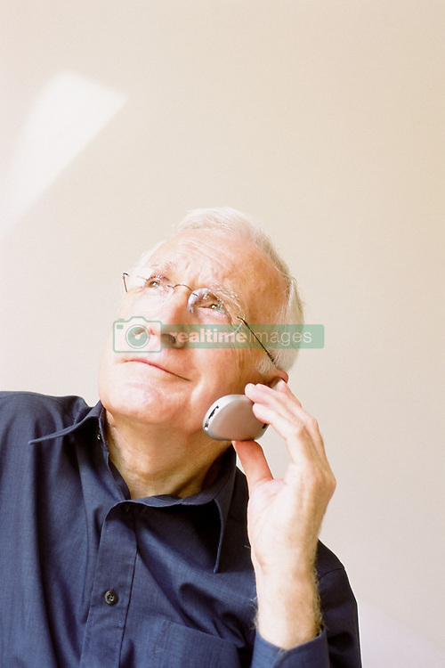 Dec. 14, 2012 - Man talking on cellphone (Credit Image: © Image Source/ZUMAPRESS.com)
