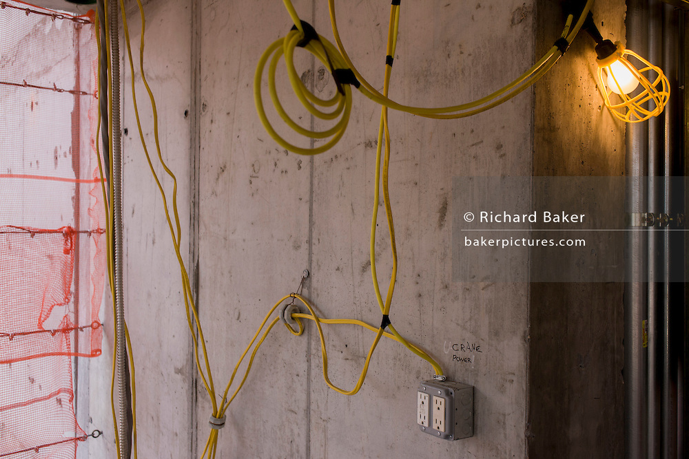 Electrical wiring during installation on New York City construction site.