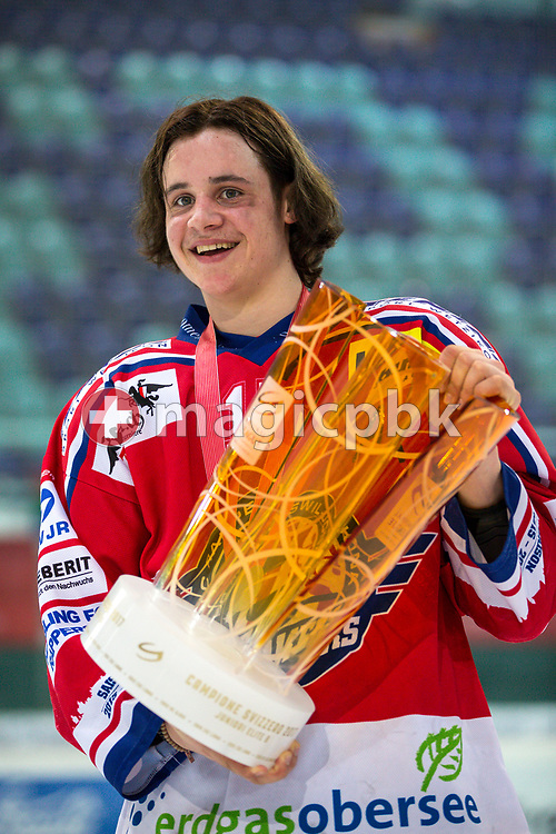Rapperswil-Jona Lakers forward Manuel Laimbacher poses for a photo with his gold medal and the Swiss Championships trophy after winning the fifth Elite B Playoff Final ice hockey game between Rapperswil-Jona Lakers and ZSC Lions held at the SGKB Arena in Rapperswil, Switzerland, Sunday, Mar. 19, 2017. (Photo by Patrick B. Kraemer / MAGICPBK)
