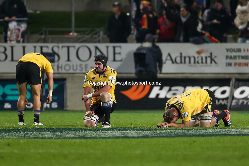 Dejected Hurricanes players after the Super 15 Rugby match - Chiefs v Hurricanes at Waikato Stadium, Hamilton, New Zealand on Friday 4 July 2014.  Photo:  Bruce Lim / www.photosport.co.nz