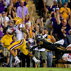 Oct 1, 2016; Baton Rouge, LA, USA;  LSU Tigers running back Derrius Guice (5) runs for a touchdown as Missouri Tigers safety Thomas Wilson (8) attempts to a make a tackle during the first quarter of a game at Tiger Stadium. Mandatory Credit: Derick E. Hingle-USA TODAY Sports
