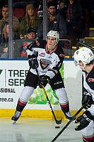 KELOWNA, BC - DECEMBER 18: Trevor Longo #4 of the Vancouver Giants passes the puck against the Kelowna Rockets  at Prospera Place on December 18, 2019 in Kelowna, Canada. (Photo by Marissa Baecker/Shoot the Breeze)