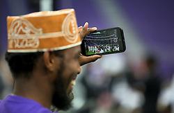 Muslim worshiper photographs the impressive setting Tuesday, August 21, 2018, at U.S. Bank Stadium in Minneapolis, MN, USA, tocelebrate Eid ul-Adha, the organization Super Eid hopes to bring together over 50,000 Muslims to pray. Photo by David Joles/Minneapolis Star Tribune/TNS/ABACAPRESS.COM