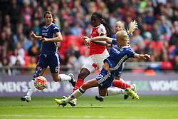 Katie Chapman of Chelsea Ladies sliding tackle on Asisat Oshoala of Arsenal Ladies - Mandatory byline: Jason Brown/JMP - 14/05/2016 - FOOTBALL - Wembley Stadium - London, England - Arsenal Ladies v Chelsea Ladies - SSE Women's FA Cup