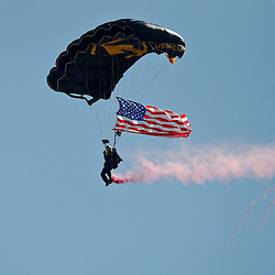 February 27, 2011; Clearwater, FL, USA; A military parachute jumper glides into the stadium prior to a spring training exhibition game between the New York Yankees and the Philadelphia Phillies at  Bright House Networks Field. Mandatory Credit: Derick E. Hingle