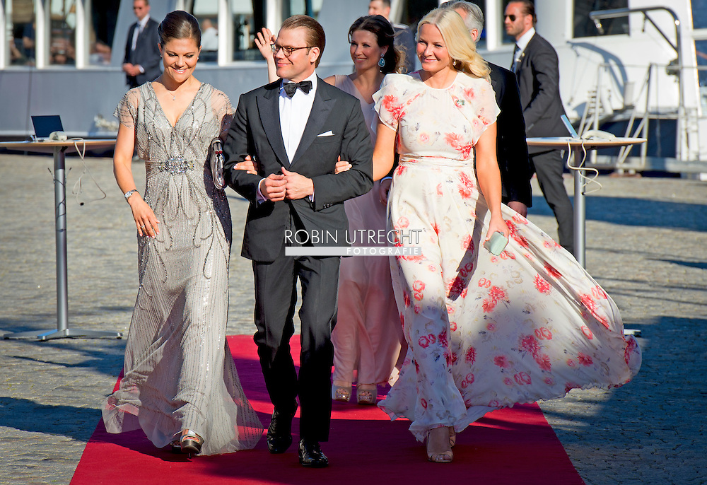 12-6-2015 STOCKHOLM -  Crown Princess Victoria and Prince Daniel and princess Mette Marit arrive at the S-S Stockholm to sail to Vaxholm Castle for a dinner before the wedding of Prince Carl Philip and Sofia Hellqvist . The wedding celebrations will begin on Friday June 12 with a private dinner for invited guests. COPYRIGHT ROBIN UTRECHT