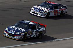 Mar 11, 2012; Las Vegas, NV, USA;  Sprint Cup Series driver Kasey Kahne (5) and driver Dale Earnhardt Jr. (88) during the Kobalt Tools 400 at Las Vegas Motor Speedway. Mandatory Credit: Jason O. Watson-US PRESSWIRE