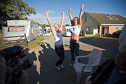 © Licensed to London News Pictures. 18/09/2011. Crays Hill, UK. Travellers from the Dale Farm Site in Essex celebrate winning a temporary injunction against the council removing them from the largest illegal traveller site in the UK  today (18/09/2011). Photo credit: Ben Cawthra/LNP