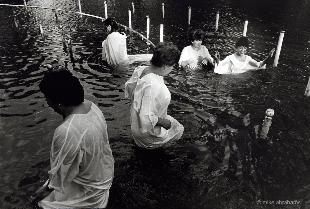 Pilgrims being baptised in the River Jordan. Kibbutz Kinneret, Israel 1999