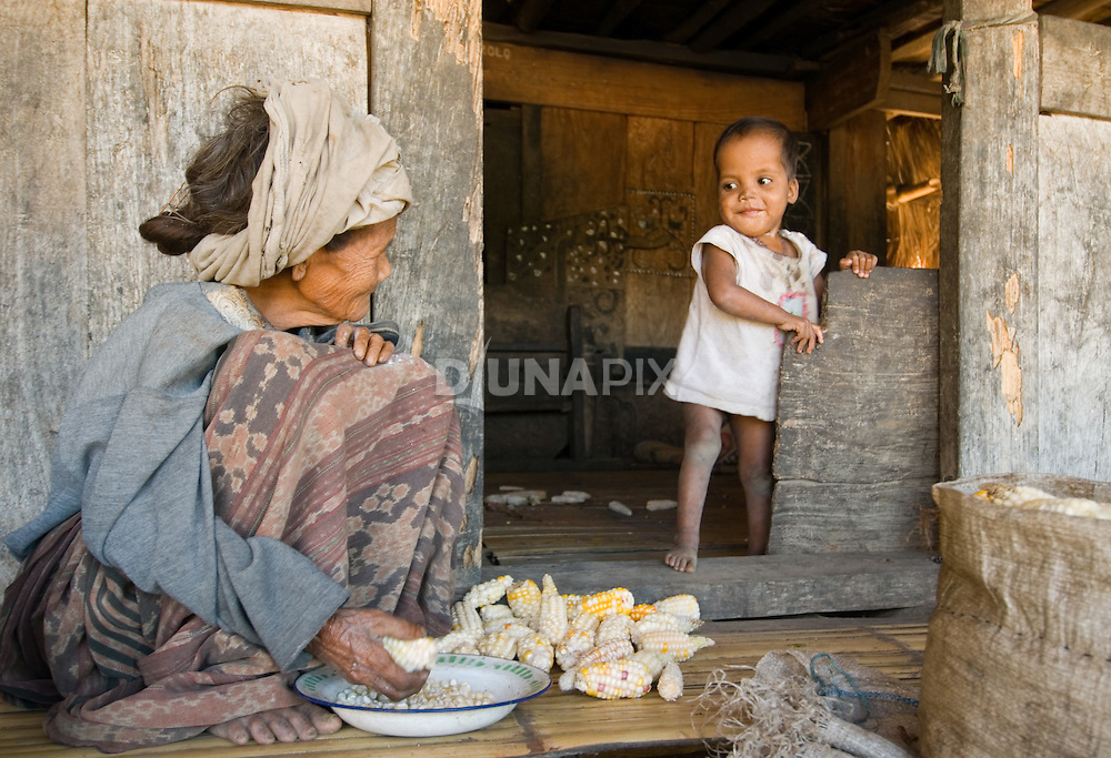 Old woman and young child, Luba village