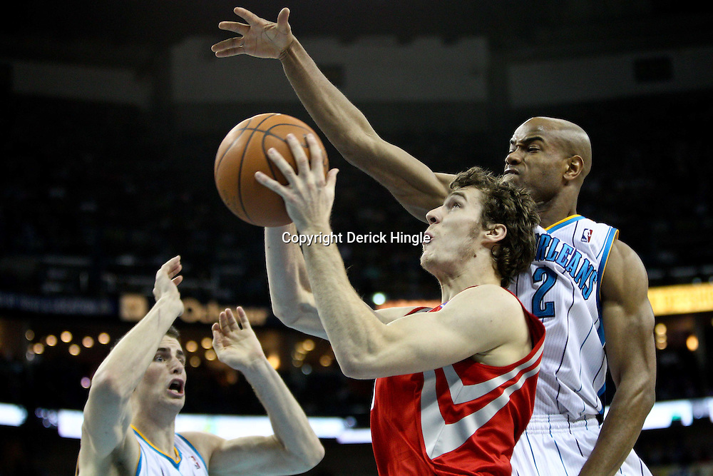 April 6, 2011; New Orleans, LA, USA; Houston Rockets point guard Goran Dragic (3) shoots as New Orleans Hornets point guard Jarrett Jack (2) and power forward Jason Smith (14) defend during the third quarter at the New Orleans Arena. The Hornets defeated the Rockets 101-93 and clinched a playoff spot with the victory.   Mandatory Credit: Derick E. Hingle-US PRESSWIRE