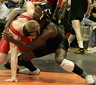 Centerville's Francois Hagenimana (right) defeated Brandon Shaffer, from Springfield North in the second round, to advance in the 2007 Division I Sectionals at Centerville High School, Friday night.
