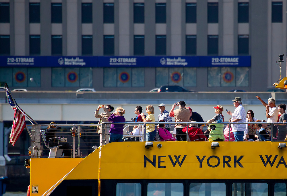 Cell phone mania on a water taxi tour boat in the East River.