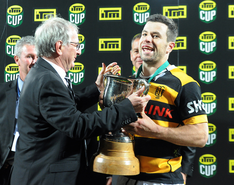 NZRU chairman Brent Impey presents the trophy to Taranaki's James Marshall after his team defeated the Tasman Makos  in the ITM Cup Rugby Premiership final match at Yarrow Stadium, New Plymouth, New Zealand, Saturday, October 25, 2014. Credit:SNPA / Ross Setford