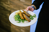 "NAPLES, ITALY - 12 SEPTEMBER 2018: Gilded, fried and stuffed anchovies are seen here at the Taverna del Buongustaio, a tavern in Naples, Italy, on September 12th 2018.<br /> <br /> Taverna del Buongustaio was founded in the 1930s by wine producer of the province of Caserta. Gaetano Aiese and his daughter Giusy have been managing the tavern since 1996. Customers of the Taverna are professors of the nearby University, students, merchants and employees of via Toledo, the commercial street right around the corner. Giusy and her father Gaetano decided to invest in the traditional Neapolitan cuisine. ""I learned cooking from my dad. And my dad learned cooking from his mother"", Giusy said."