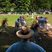 August 31, 2009 - Bronx, NY : The Riverdale Country School football team spent much of the day working out at the school's lower school campus on Monday.  Riverdale head coach Declan Walsh watches as his team runs through drills.