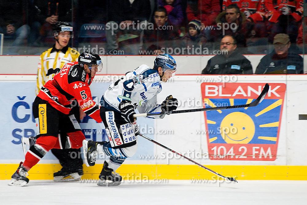30.11.2014, Ice Rink, Znojmo, CZE, EBEL, HC Orli Znojmo vs EHC Black Wings Linz, 23. Runde, im Bild v.l. Jiri Klimicek (HC Orli Znojmo) Daniel Mitterdorfer (Linz) // during the Erste Bank Icehockey League 23rd round match between HC Orli Znojmo and EHC Black Wings Linz at the Ice Rink in Znojmo, Czech Republic on 2014/11/30. EXPA Pictures © 2014, PhotoCredit: EXPA/ Rostislav Pfeffer