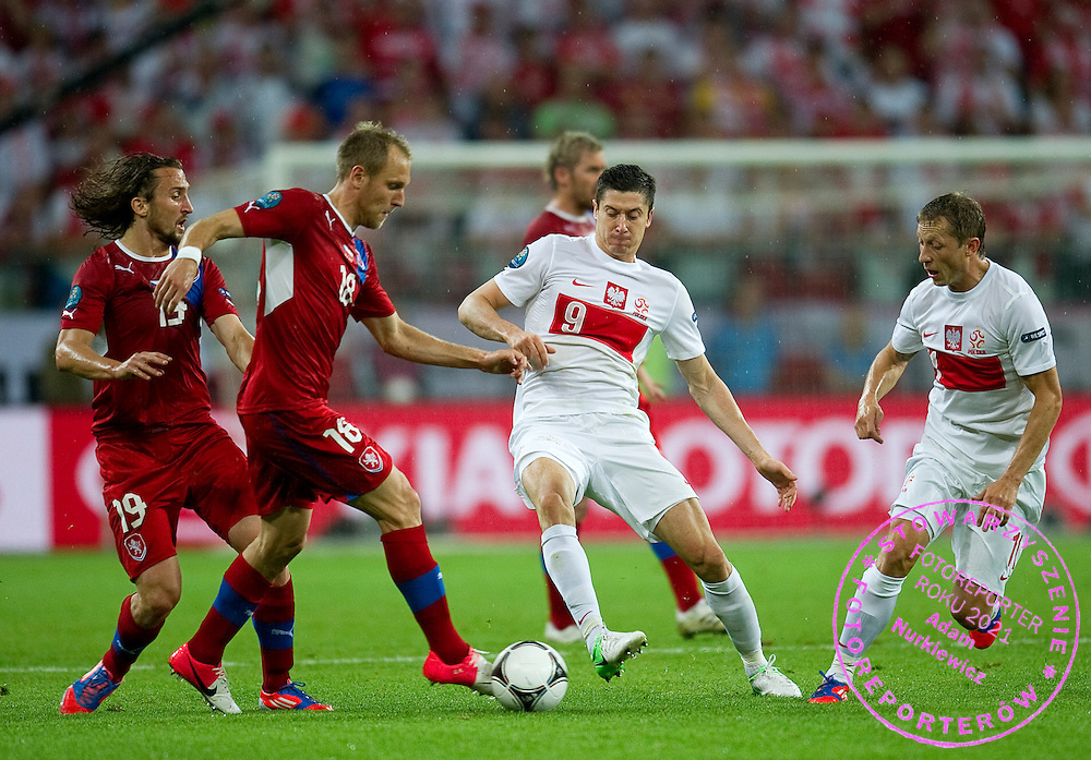 (R) Poland's Robert Lewandowski (nr09) fights for the ball with Czech's Daniel Kolar (nr18) during the UEFA EURO 2012 Group A football match between Poland and Czech Republic at Municipal Stadium in Wroclaw on June 16, 2012...Poland, Wroclaw, June 16, 2012..Picture also available in RAW (NEF) or TIFF format on special request...For editorial use only. Any commercial or promotional use requires permission...Photo by © Adam Nurkiewicz / Mediasport