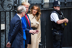 London, UK. 4 June, 2019. US President Donald Trump, First Lady Melania Trump, Prime Minister Theresa May and her husband Philip May pose outside 10 Downing Street before lunch and talks on the second day of his state visit to the UK.