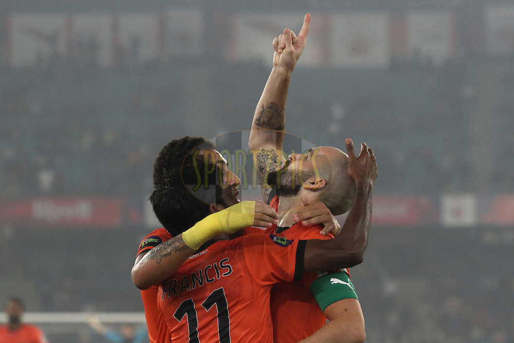 Gustavo Marmentini dos Santos of Delhi Dynamos FC and Francisco Fernandez of Delhi Dynamos FC congratulate as Delhi Dynamos FC captain Hans Mulder celebrates scoring the opening goal during match 43 of the Hero Indian Super League between The Delhi Dynamos FC<br /> and Mumbai City FC held at the Jawaharlal Nehru Stadium, Delhi, India on the 28th November 2014.<br /> <br /> Photo by:  Shaun Roy / ISL/ SPORTZPICS