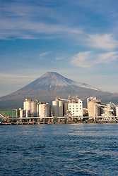 Mount Fuji behind industrial harbor, Japan