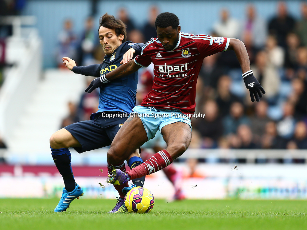 25 October 2014 - Barclays Premier League - West Ham v Manchester City - David Silva of Manchester City tangles with Alex Song of West Ham - Photo: Marc Atkins / Offside.