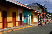 Colorful 19th century wooden houses and three wheel taxis are a common sight in the Pacific port town of El Corinto, Nicaragua.