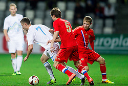 Andraz Sporar of Slovenia vs Andrey Semenov of Russia and Dmitry Efremov of Russia during football match between U21 National Teams of Slovenia and Russia in 6th Round of U21 Euro 2015 Qualifications on November 15, 2013 in Stadium Bonifika, Koper, Slovenia. Russia defeated Slovenia 1-0. Photo by Vid Ponikvar / Sportida