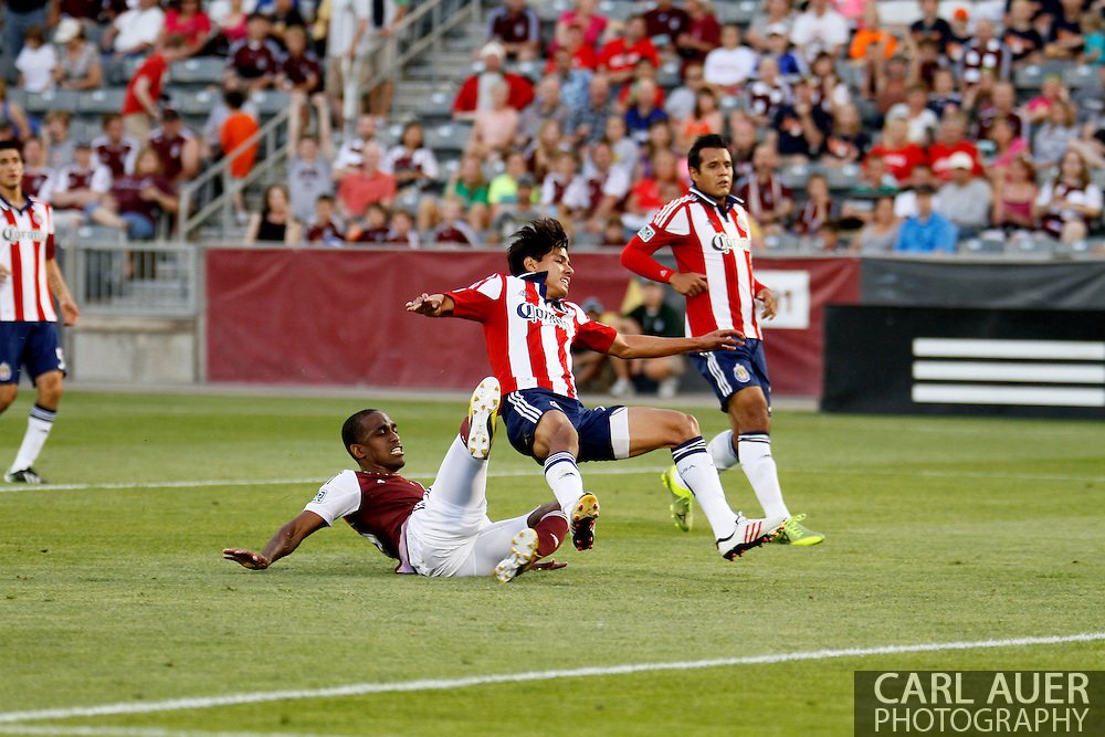 May 25th, 2013 Commerce City, CO - Colorado Rapids midfielder Atiba Harris (16) falls to his back as he scores the lone 1st half goal in the MLS match between Chivas USA and the Colorado Rapids at Dick's Sporting Goods Park in Commerce City, CO