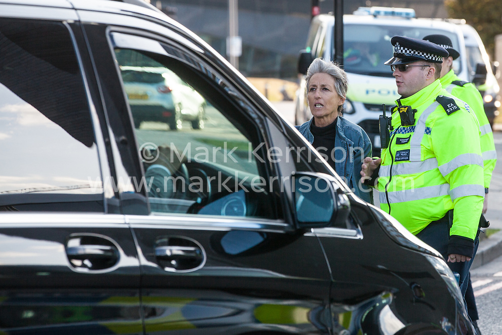 London, UK. 7 September, 2019. A Metropolitan Police officer pushed back an activist blocking the road in front of a vehicle outside ExCel London on the sixth day of Stop The Arms Fair protests against DSEI, the world's largest arms fair. The sixth day of protests was billed as a Festival of Resistance and included performances, entertainment for children and workshops as well as activities intended to disrupt deliveries to ExCel London for the arms fair.