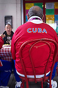 Fans of the Cuban Olympic team enjoy breakfast at a London 'greasy' Cafe