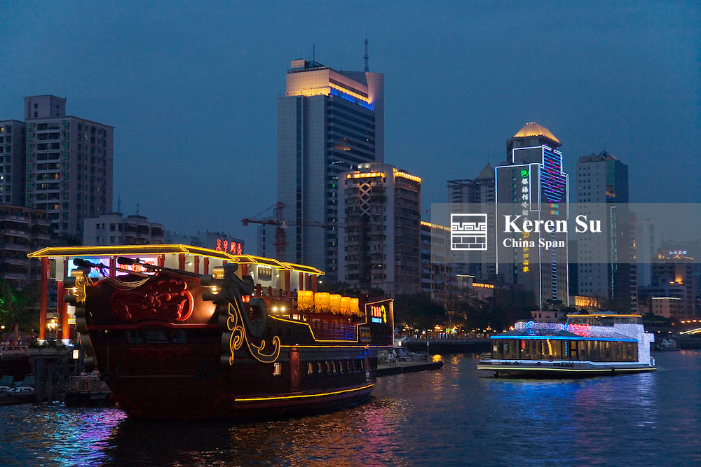 Night view of cruise ship and modern highrises along Pearl River, Guangzhou, Guangdong Province, China
