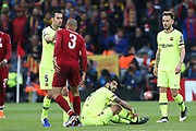Liverpool midfielder Fabinho (3) lets Barcelona forward Luis Suarez (9)  know what he thinks about the Barcelona strikers antics during the Champions League semi-final, leg 2 of 2 match between Liverpool and Barcelona at Anfield, Liverpool, England on 7 May 2019.