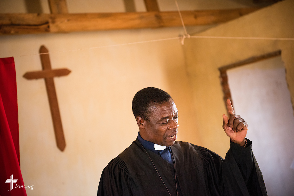 The Rev. Davis Wowa, executive chairman of the Confessional Lutheran Church–Malawi Synod, prays during worship in a parish on Saturday, Sept. 26, in Embangweni, Malawi. LCMS Communications/Erik M. Lunsford