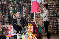 Model Anna Freemantle with student Hannah McKinnon, showing fashion students about upcycling clothes, at the UK&rsquo;s second largest textile recycling facility, Nathan&rsquo;s Wastesavers, in Denny.<br /> &copy; Michael Schofield.