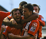 Picture by David Horn/Focus Images Ltd +44 7545 970036.05/01/2013.Alex Lawless (left) of Luton Town is mobbed by team mates after scoring the opening goal during the The FA Cup match at Kenilworth Road, Luton.